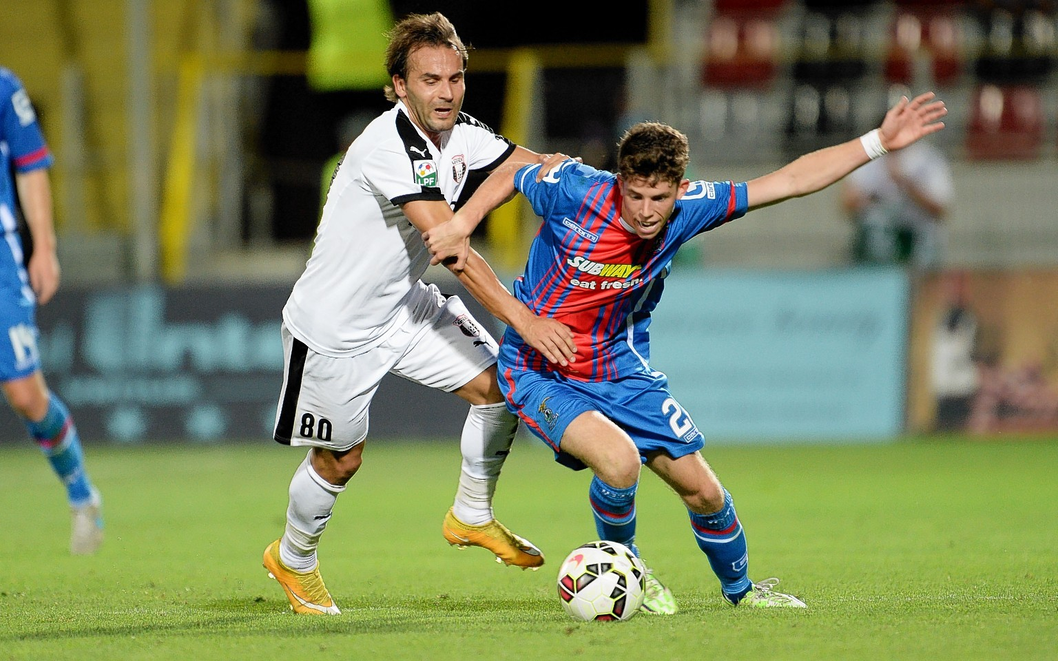 Ryan Christie (right) holds off Filipe Teixeira in Romania