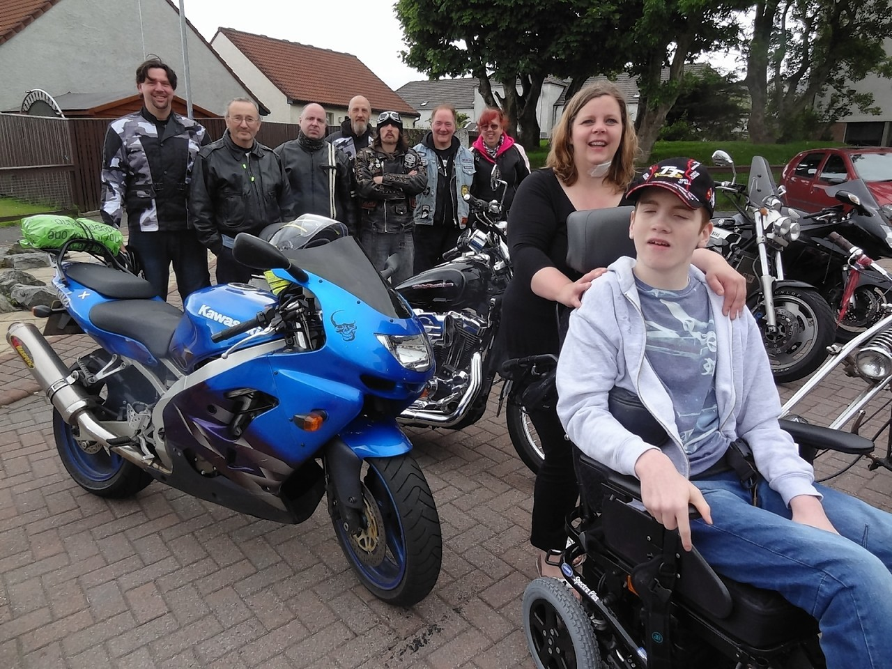 Shaun Hill and mother, Barbara, with some of the bikers
