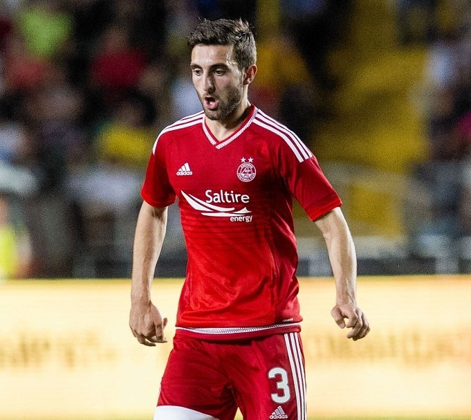 Shinnie on the ball against Kairat