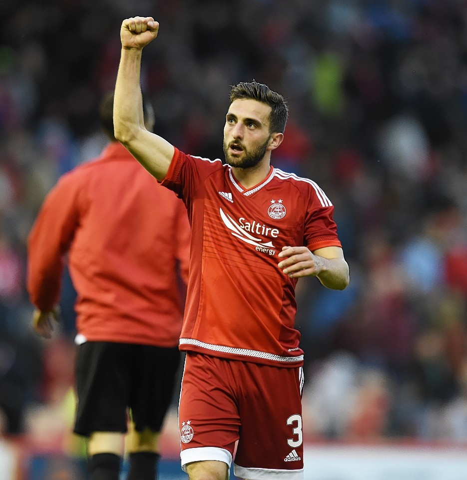 Graeme Shinnie will miss Saturday's trip to Inverness