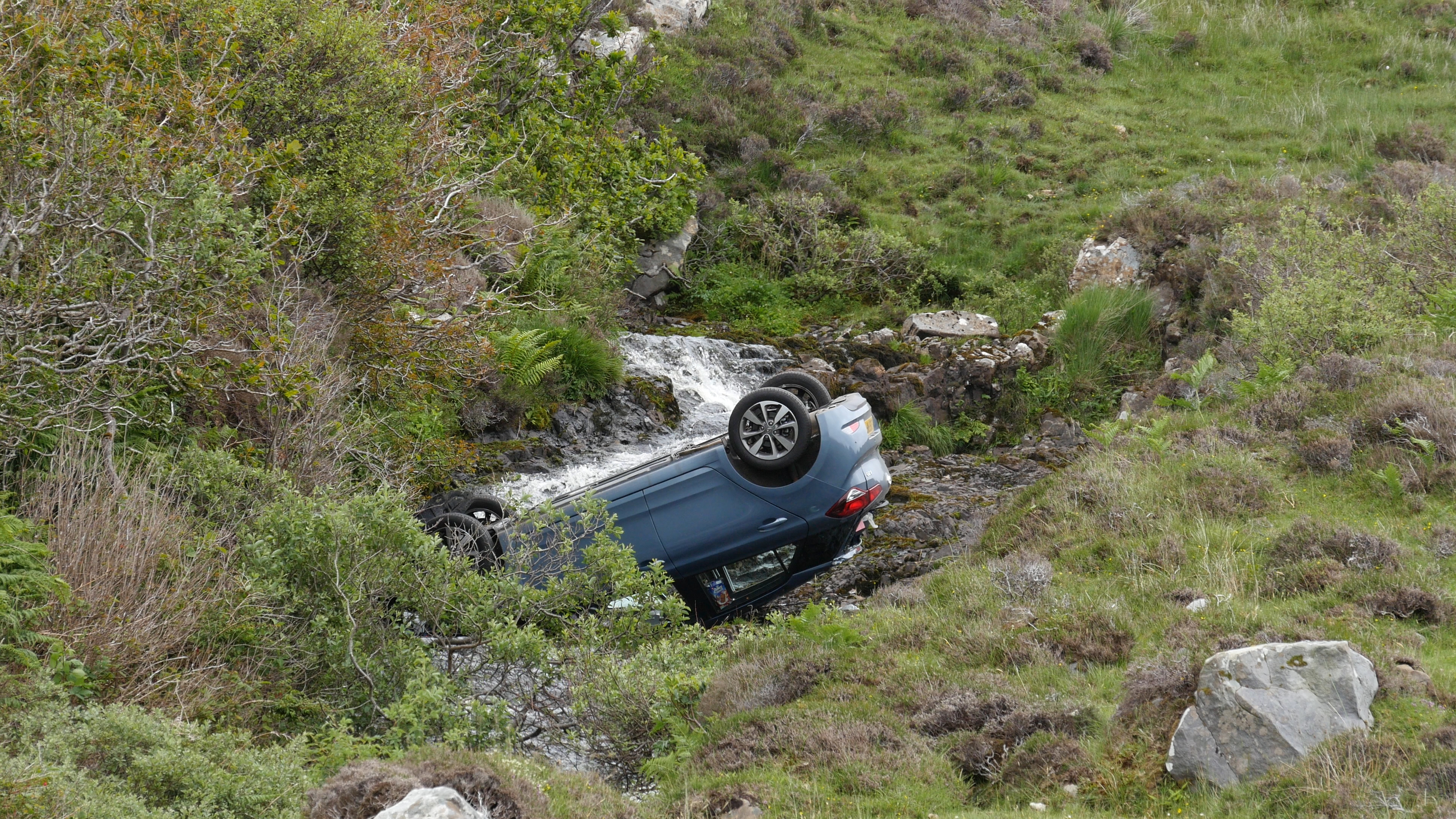 The car landed on its roof in the burn
