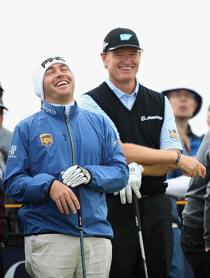 Louis Oosthuizen of South Africa and Ernie Els of South Africa joke on the 13th tee ahead of the 144th Open Championship at The Old Course