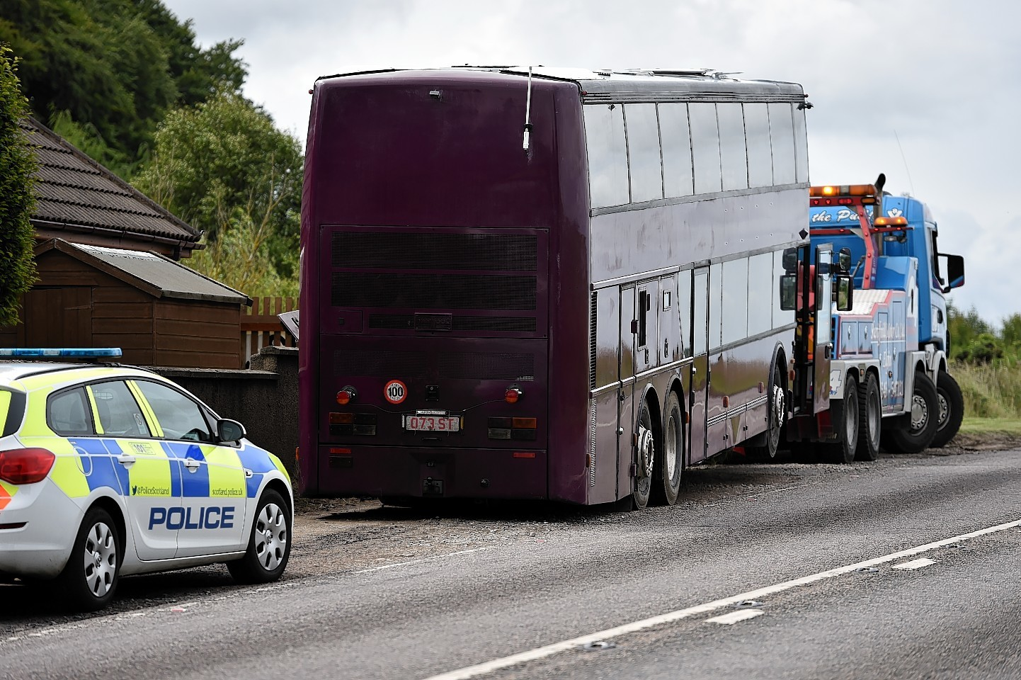 The bus which caught fire on the A96 at Threaplands, near Lhanbryde. Picture by Gordon Lennox