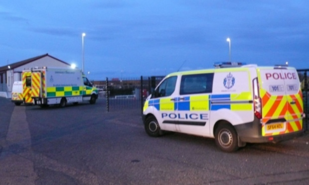 Police at the scene in Arbroath where the woman's body was found. Credit: The Courier