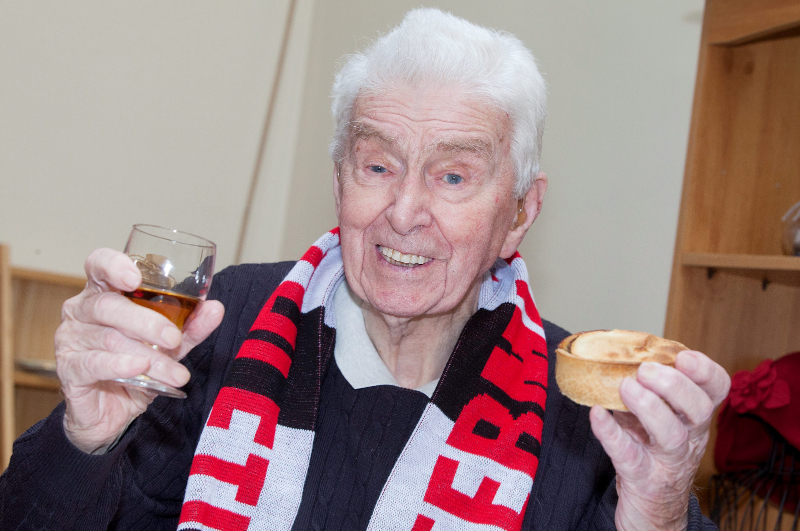 James Crombie with his two favourite things - a pie and a brandy