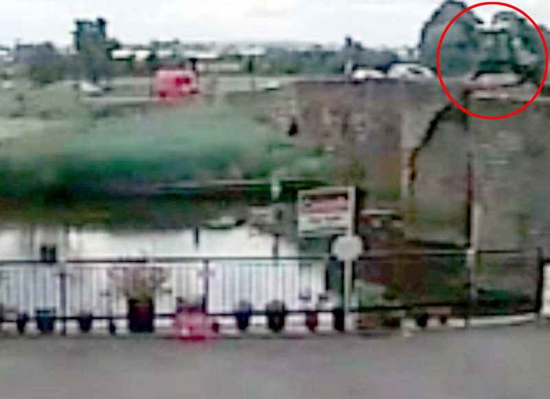 The moment the tractor driver crashed into a 15th century bridge
