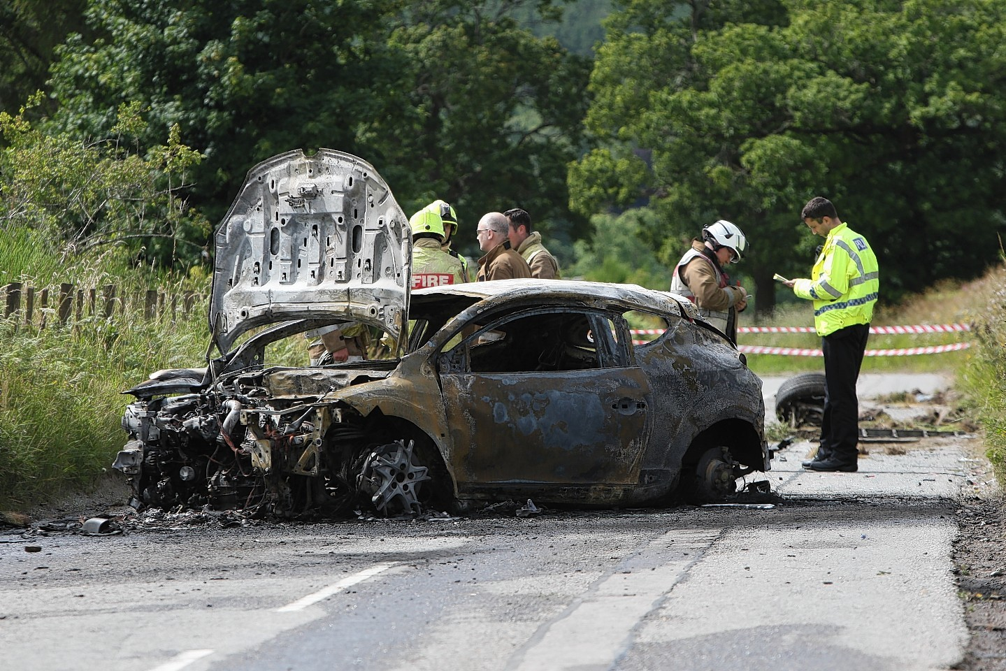 The remains of the burnt out car on the A831 near Kilmorack Gallery