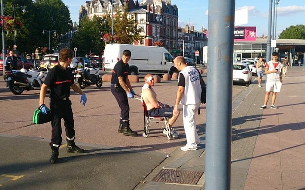 An injured man is wheeled away from Arras train station. Picture from @AdaSilvaArras