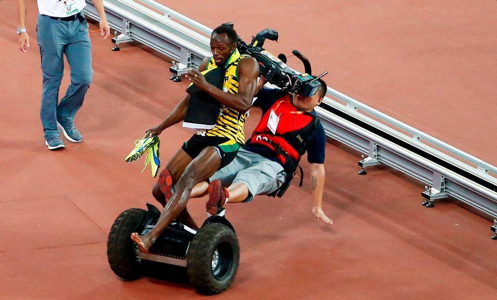 The cameraman on his segway crashes into Usain Bolt