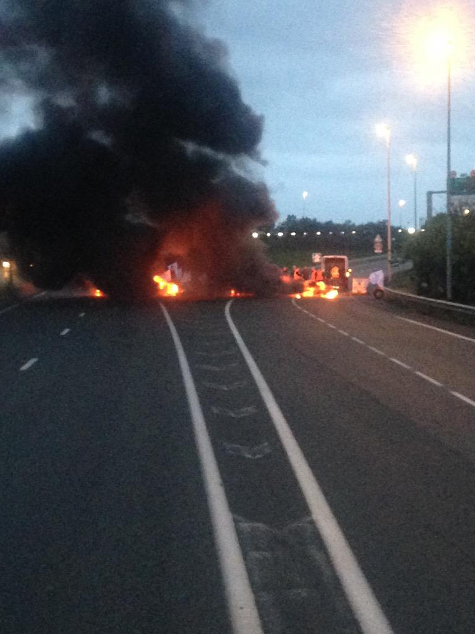 A burning blockade as French ferry workers strike in Calais.
