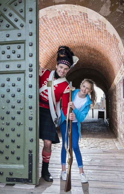Emma Gillespie, 11, steps back in time with a Napoleonic era redcoat soldier at Fort George