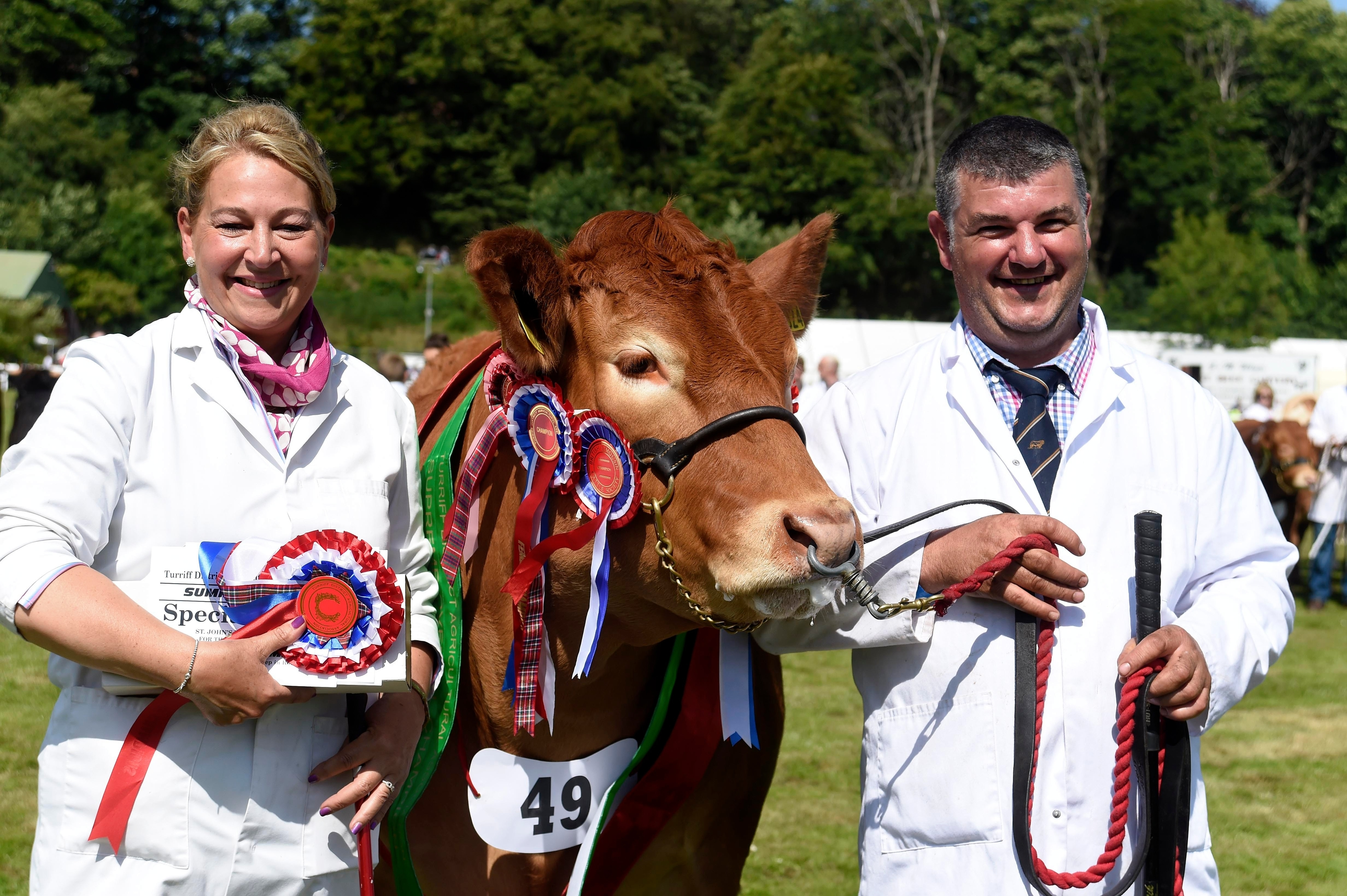 Doug McBeath and Sarah Jayne Jessop celebrate after taking best in show overall with poolehall iris, their limousin champion.