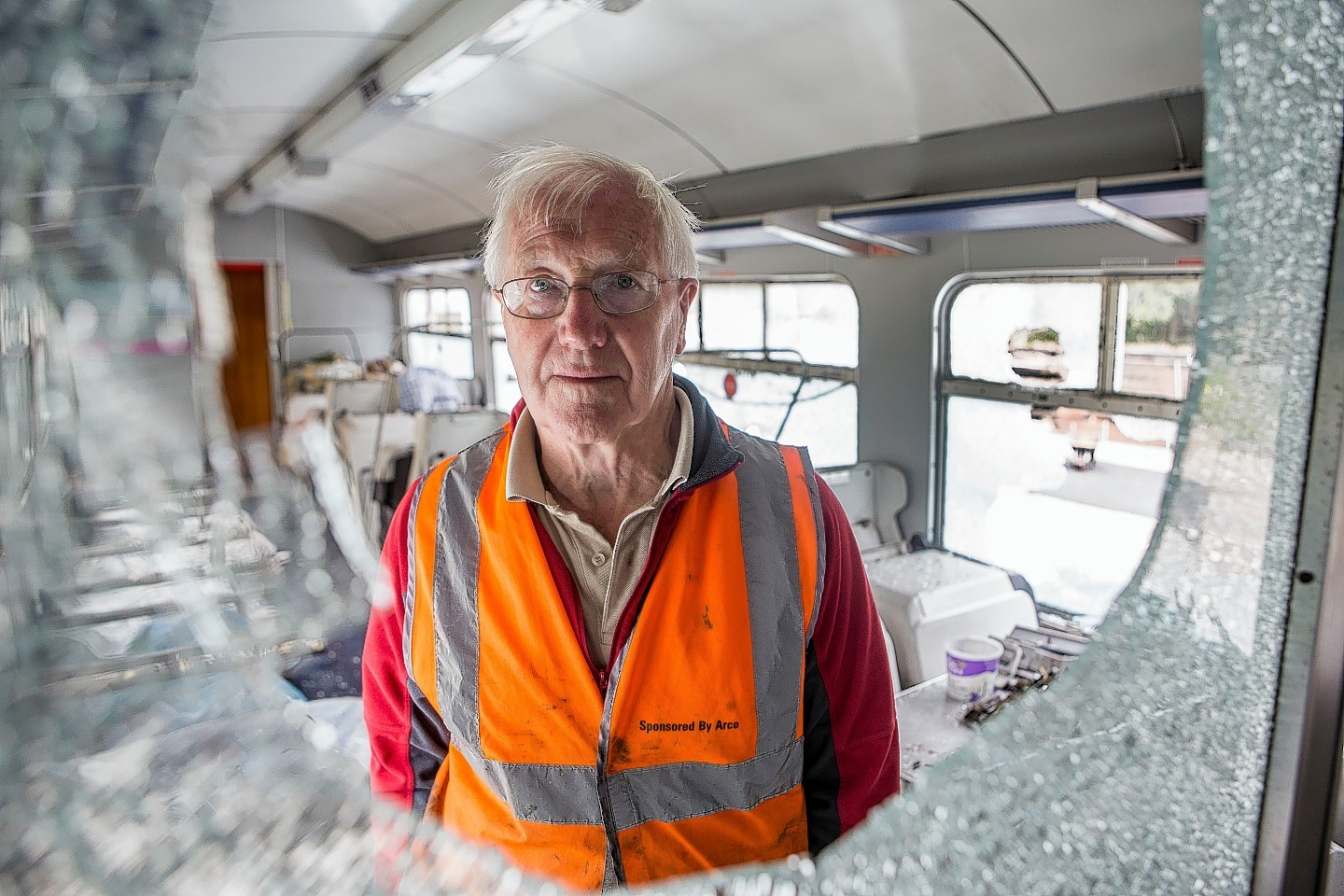 Bill Halliday inspecting the damage to the Royal Deeside carriage