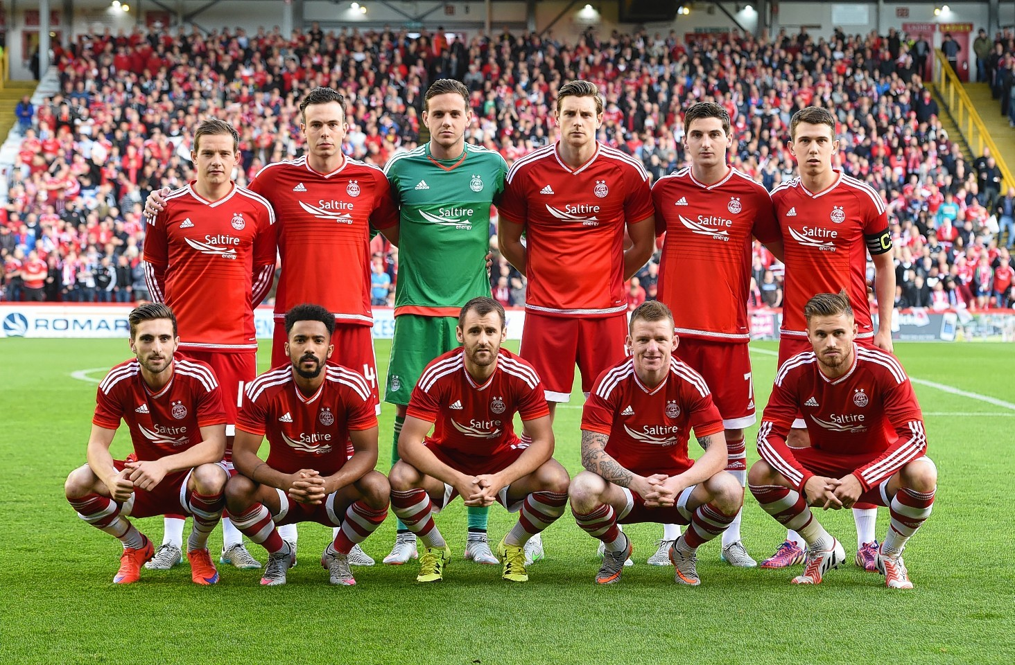 The Dons line up ahead of the match