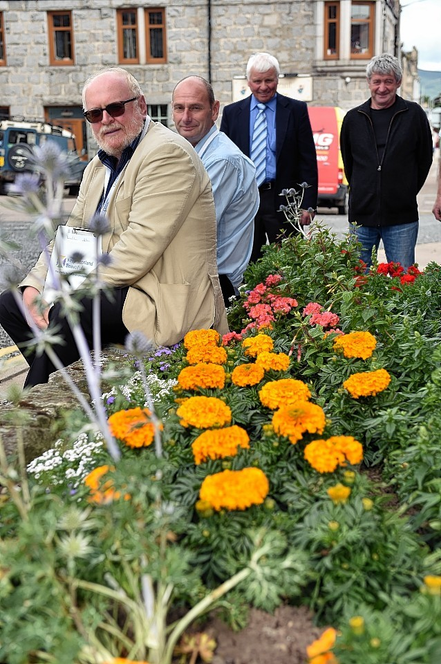 Judges Stan Da Prato, and Andrew Hogarth, with Ally MacDonald, chairman Dufftown In Bloom, and Sandy Findlay. Picture by Gordon Lennox