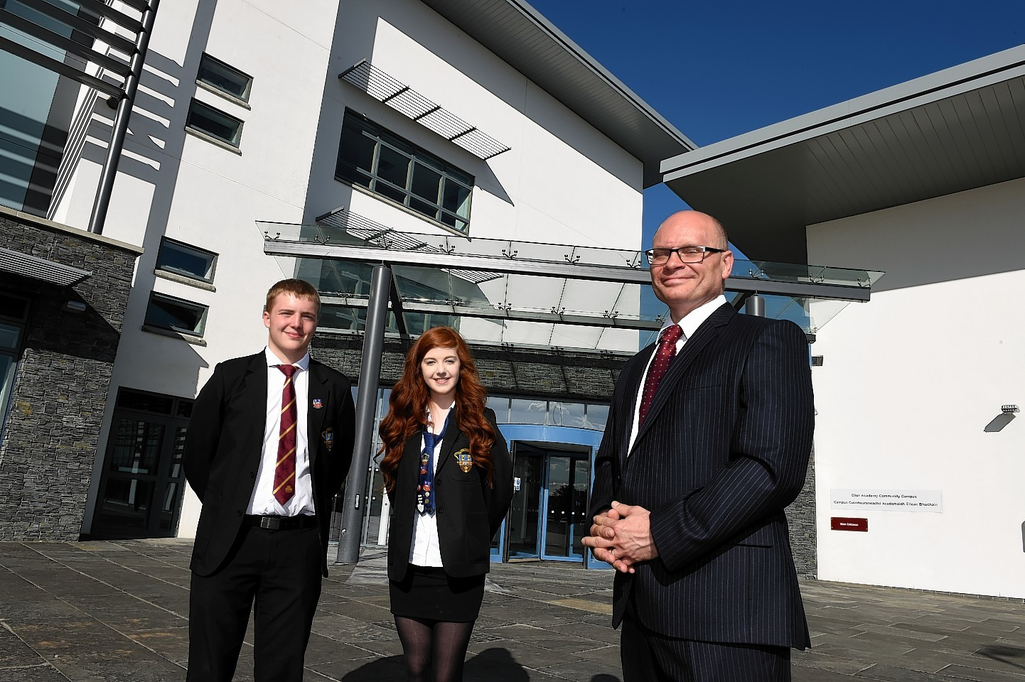 Head pupil's Max Poole and Jennifer Hendry with rector Tim McKay at the opening of the £36million Ellon Academy Community Campus at Cromleybank.  Picture by KEVIN EMSLIE