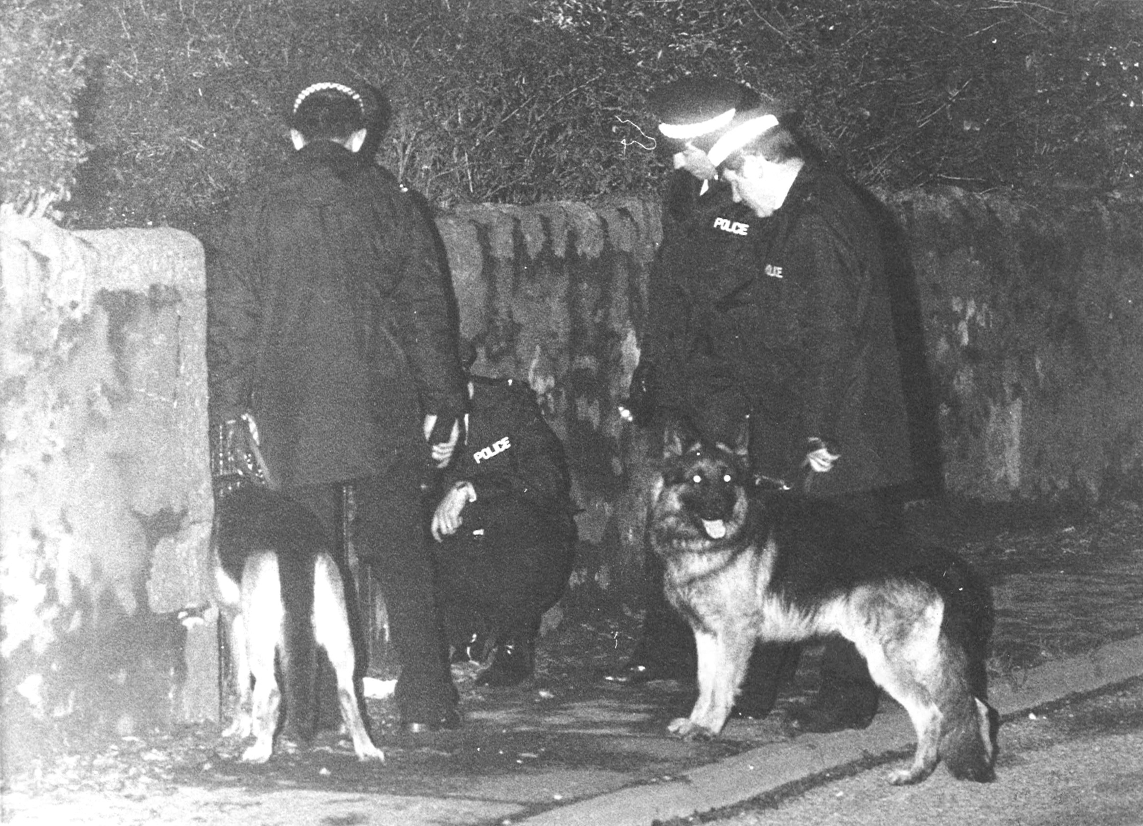 Police and dogs involved in the search following the murder