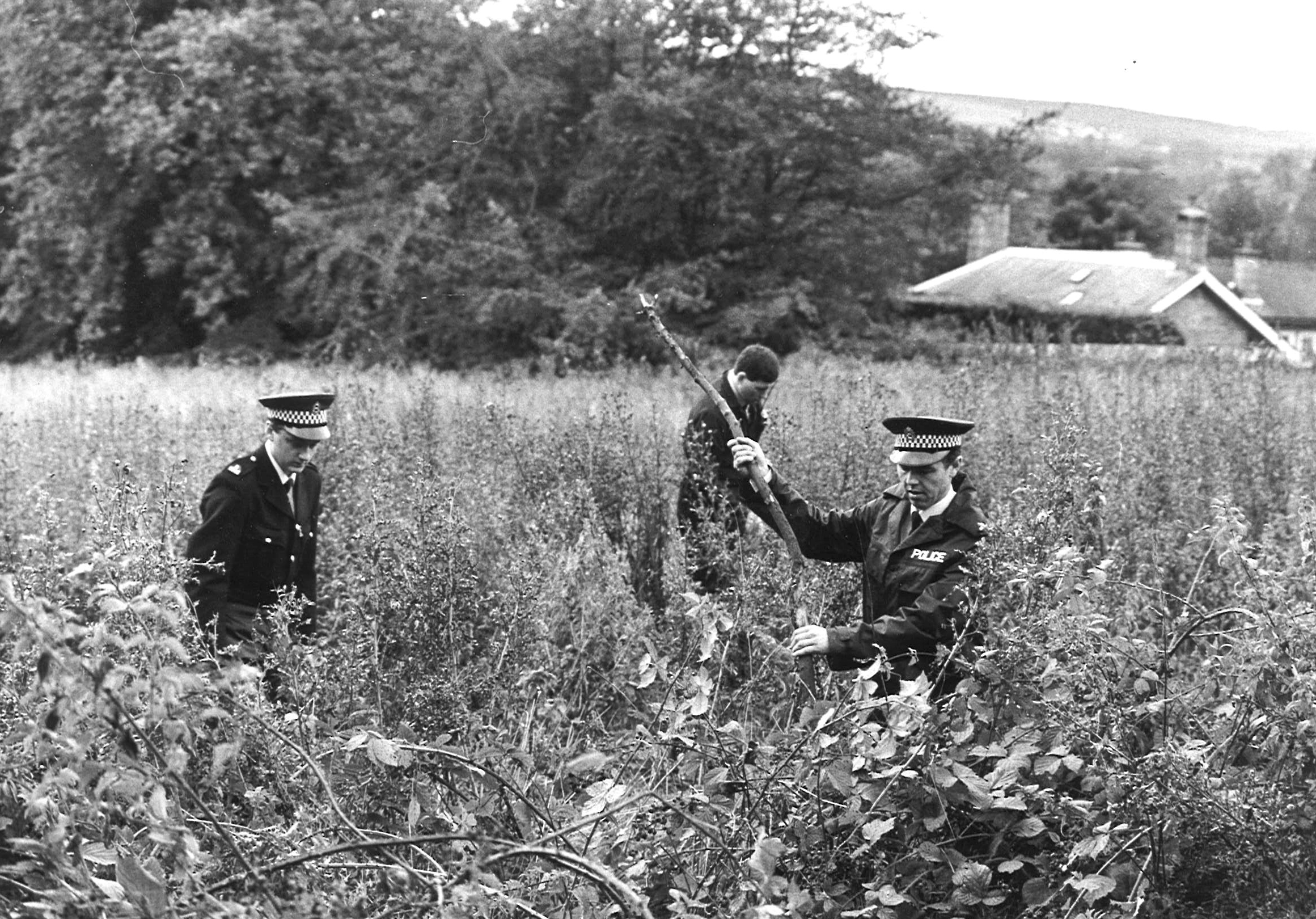 Police search thick undergrowth at Station Road, Pitfodels