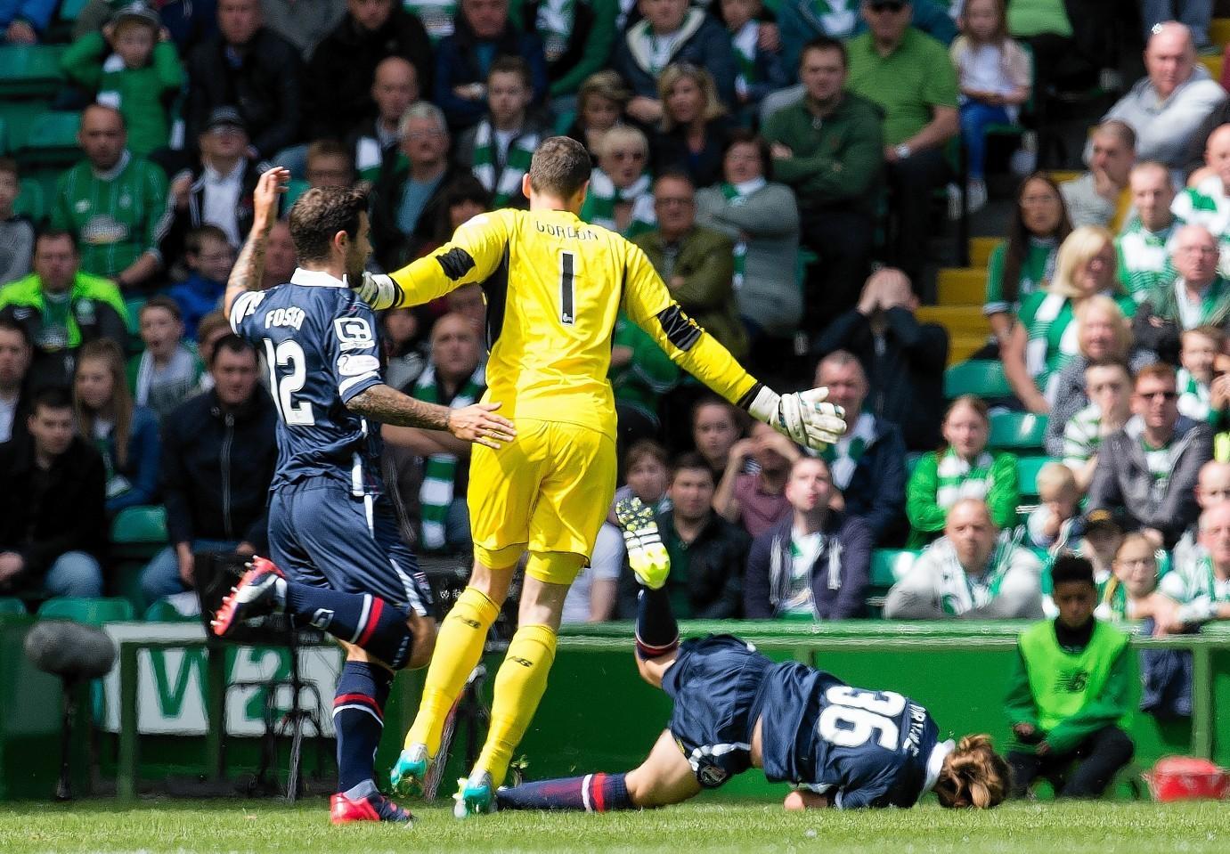 Jackson Irvine is floored by Celtic keeper Craig Gordon