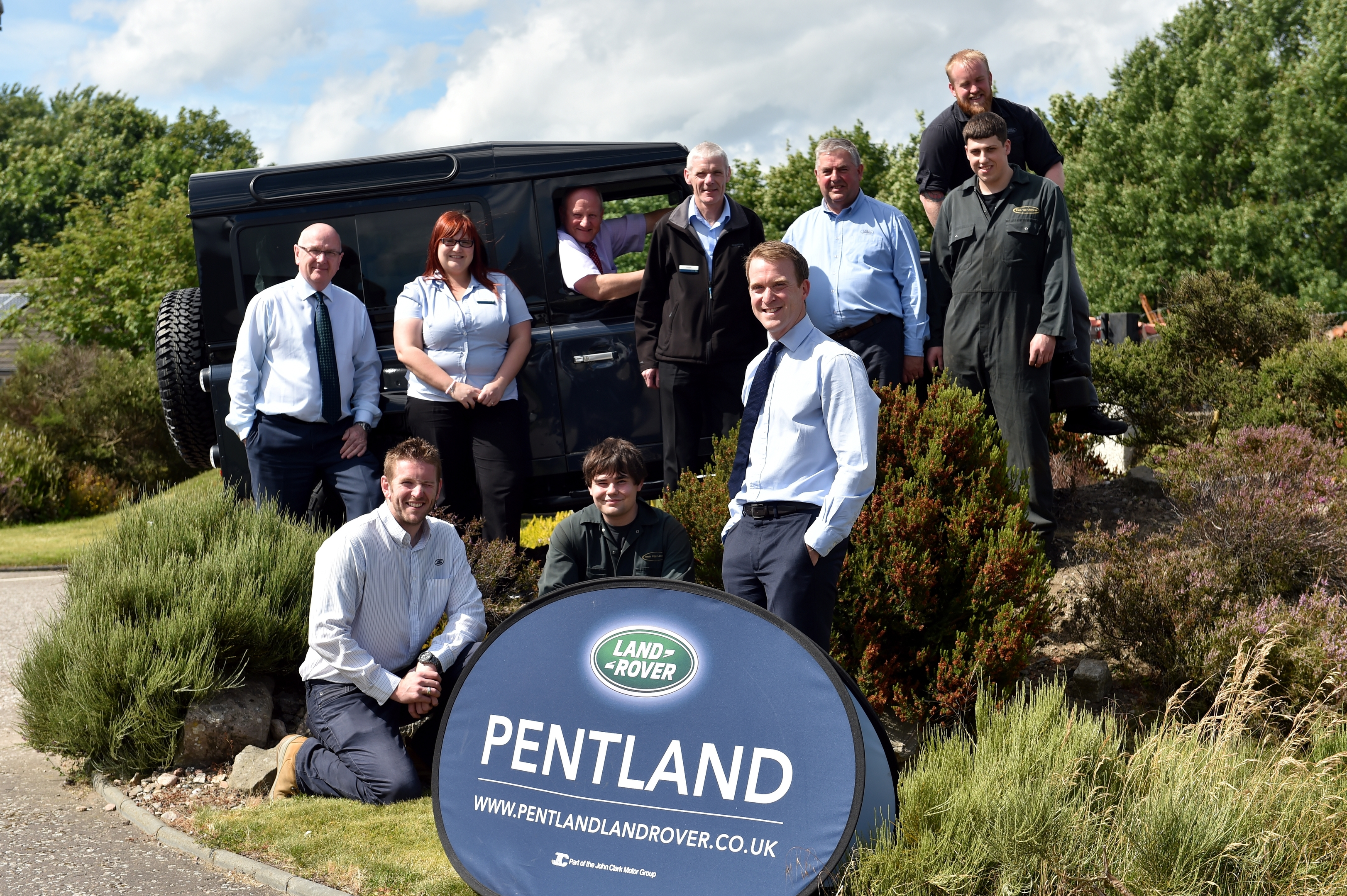 Chris Clark, Business Development Director, John Clark Motor Group, at their latest aquisition, Pentland Land Rover (Elgin), with some of the staff.