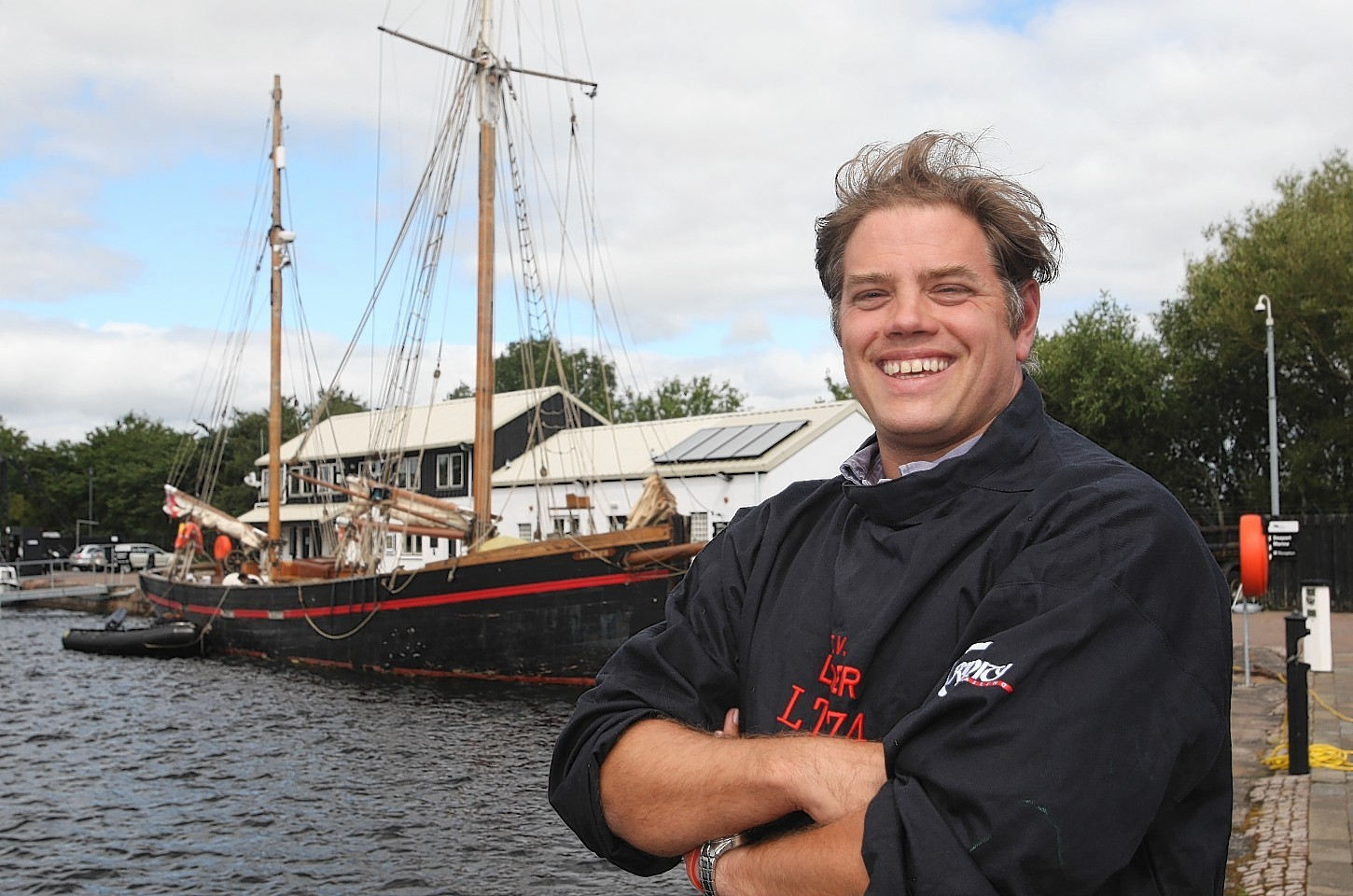 Skipper Ben Swain with the historic ship, Leader, in Inverness