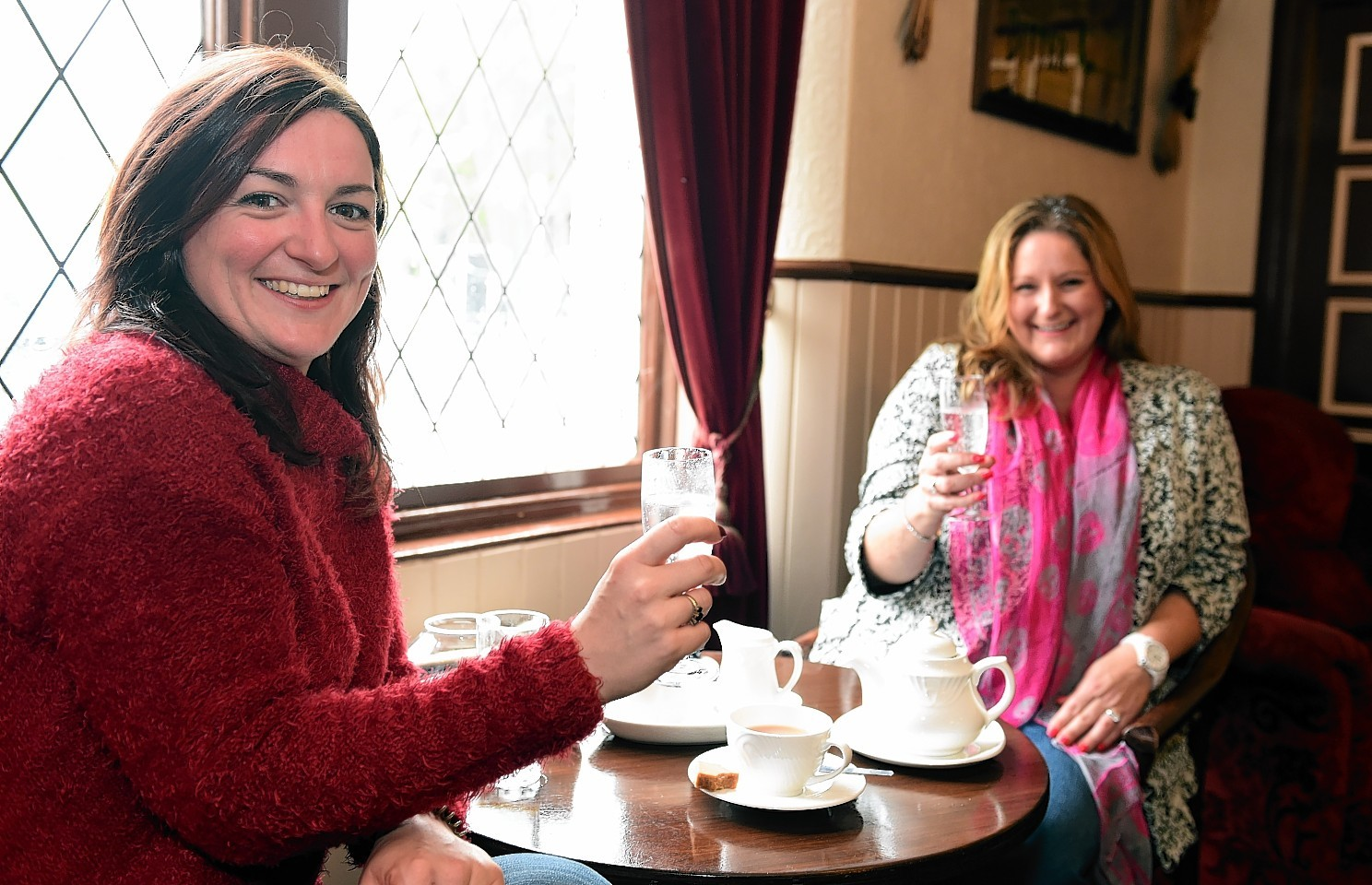 Old regular customers Grace Cranna (left) and Jenny Strachan at the inn on it's first day back open.       Picture by Kami Thomson