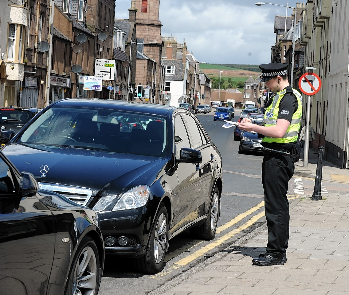 Operation Cedar as Police Scotland's, PC Colin Logan, walks the streets of Stonehaven. (The driver of this car did not get a ticket) Picture by JIM IRVINE    30-5-15