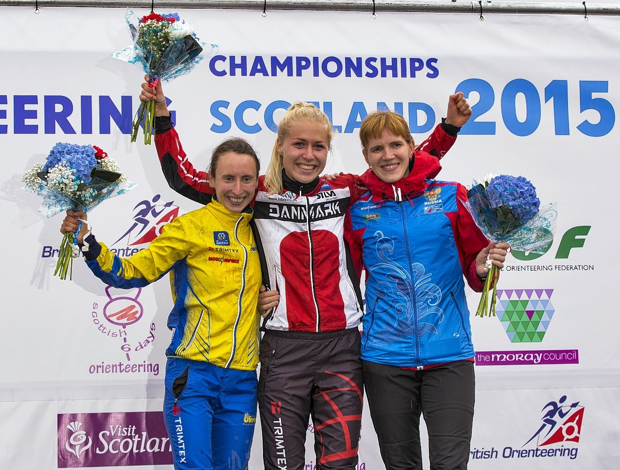 Maja Alm from Denmark celebrates winning the ladies championship at the World Orienteering Championships