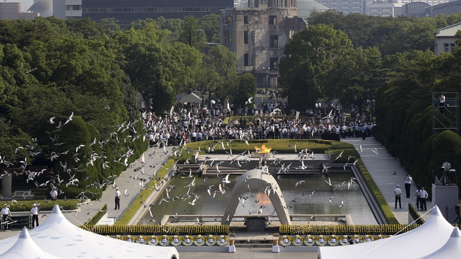 Doves fly over the cenotaph dedicated to the victims of the atomic bombing at the Hiroshima Peace Memorial Park (AP)