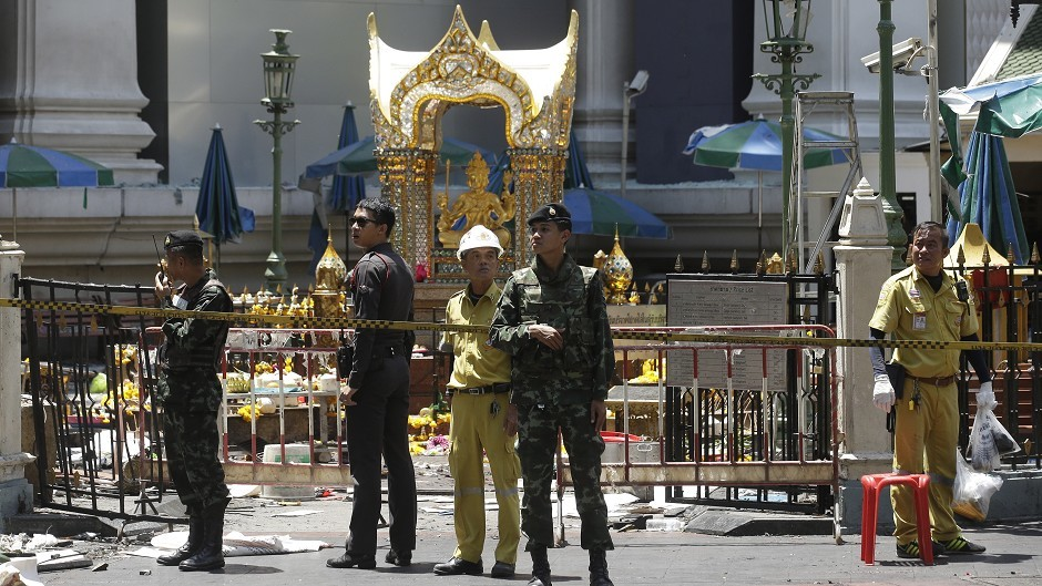 Police, soldiers and other officials at the Erawan Shrine the day after the explosion