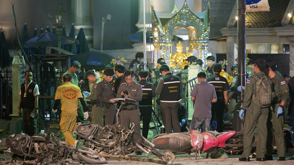 Police investigate the scene at the Erawan Shrine  in Bangkok after an explosion (AP)