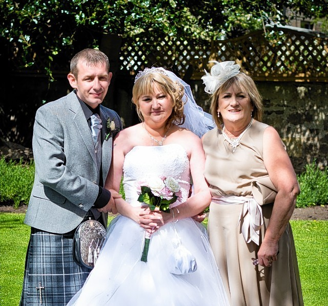 Paula McPherson McIntrye on her wedding day with husband Peter McIntyre and mother Aileen McPherson