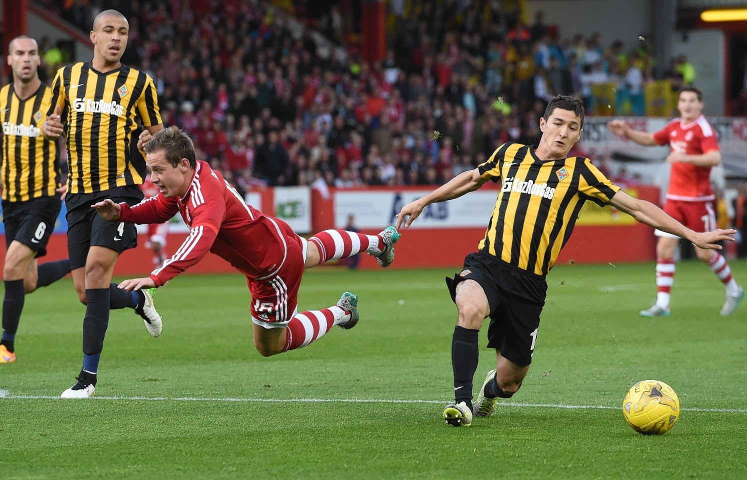 Pawlett felt he should have had a penalty for this challenge from Kuantayev