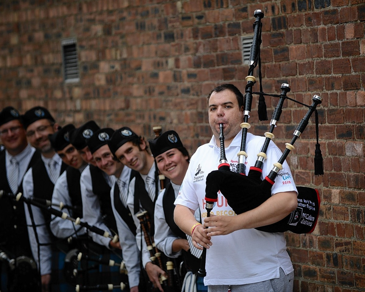 Piper Rikki Evans with the Catamount Pipe Band
