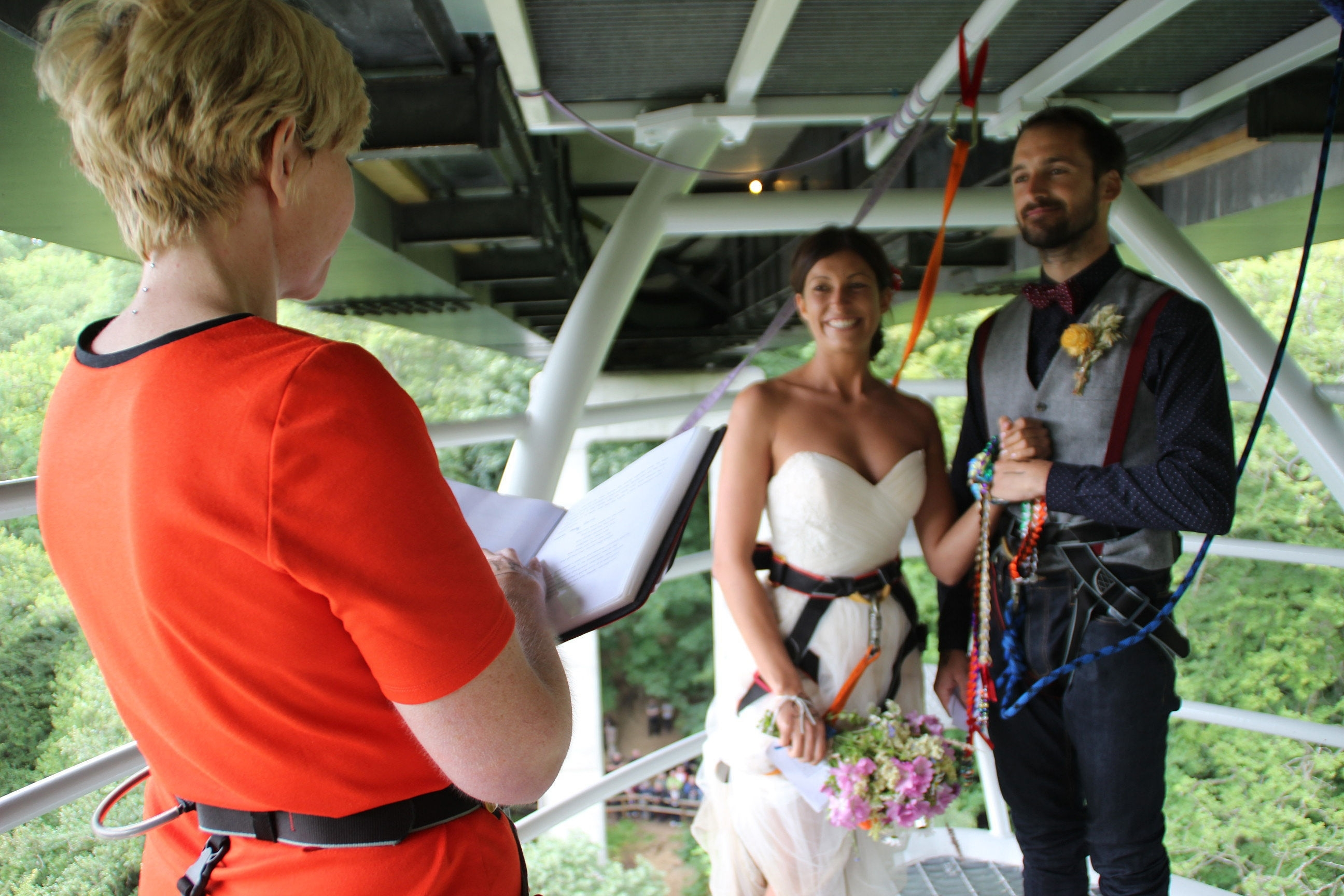 Undated handout photo issued by Highland Fling Bungee of Ross Basham, 33, and Hannah Phillips, 27, who jump-started married life by holding their wedding on a bungee jump platform and then leapt 40 metres on the same cord at Garry Bridge near Killiecrankie in Perthshire. PRESS ASSOCIATION Photo. Issue date: Thursday August 6, 2015. It is thought to be the first wedding of its kind to be conducted in Scotland, with the vows legally witnessed by the company's jump crew who were wearing traditional highland dress. See PA story SOCIAL Bungee. Photo credit should read: Highland Fling Bungee/PA Wire NOTE TO EDITORS: This handout photo may only be used in for editorial reporting purposes for the contemporaneous illustration of events, things or the people in the image or facts mentioned in the caption. Reuse of the picture may require further permission from the copyright holder.