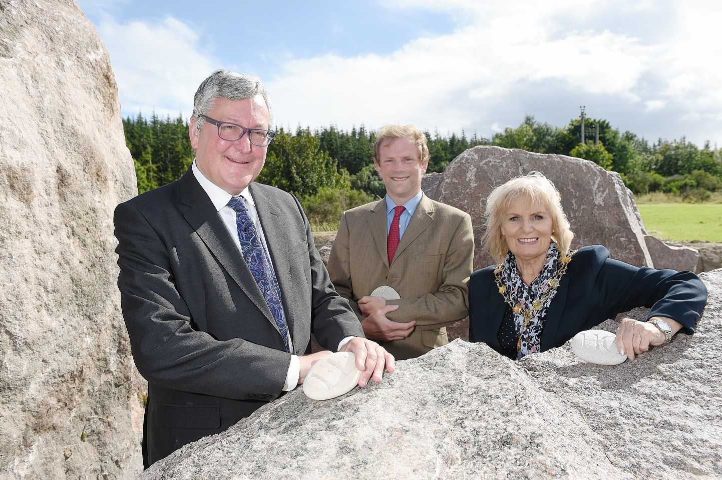 Fergus Ewing MSP, John Stuart Earl of Moray and Helen Carmichael with their initials carved in pebbles beside the giant boulders marking the start of the development.