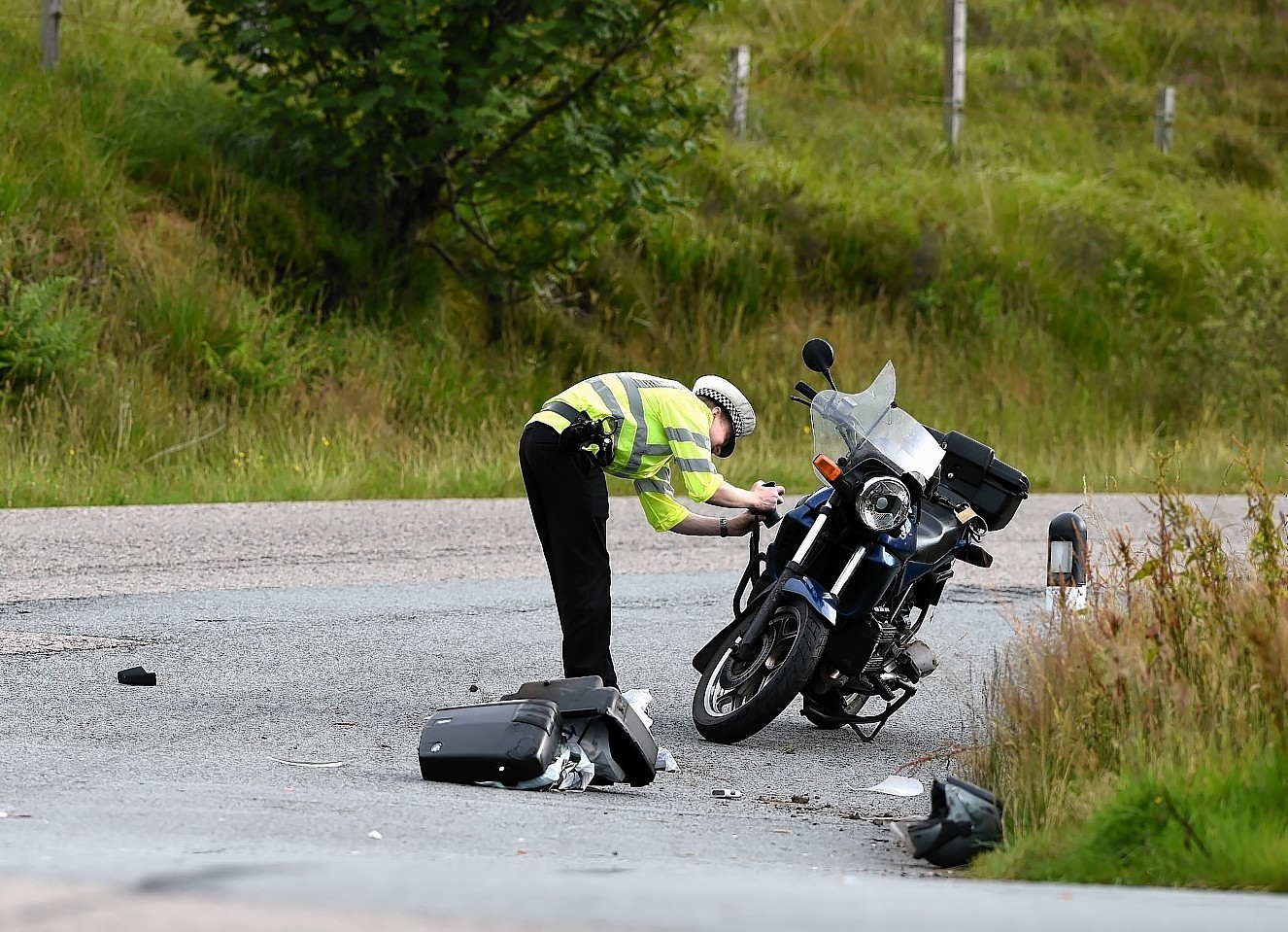 A police officer at the scene of a fatal motorcycle accident in Wester Ross