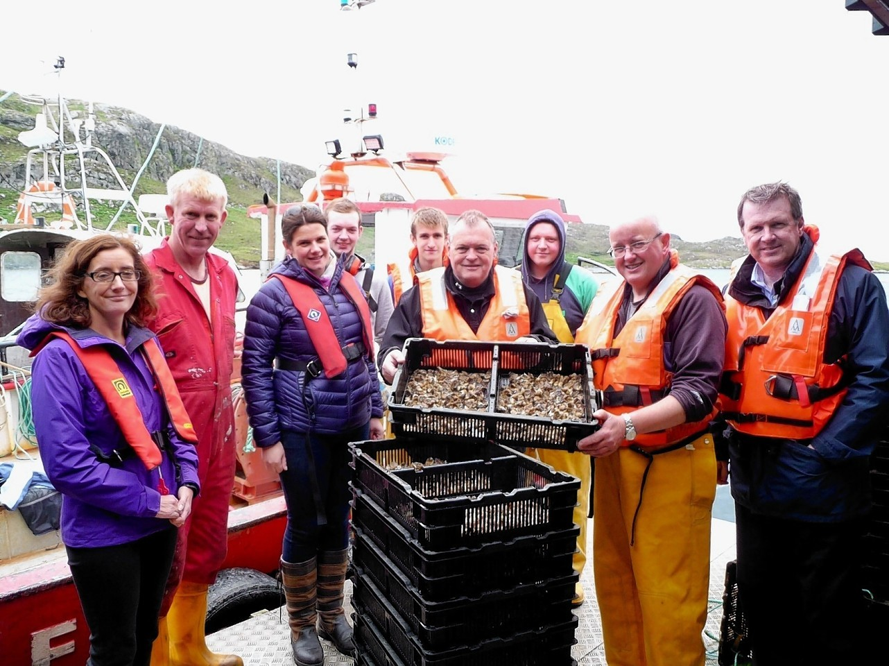 HIE director of business and sector development, Charlotte Wright (left) and chief executive, Alex Paterson (right), on a recent visit to Traigh Mhor Oysters