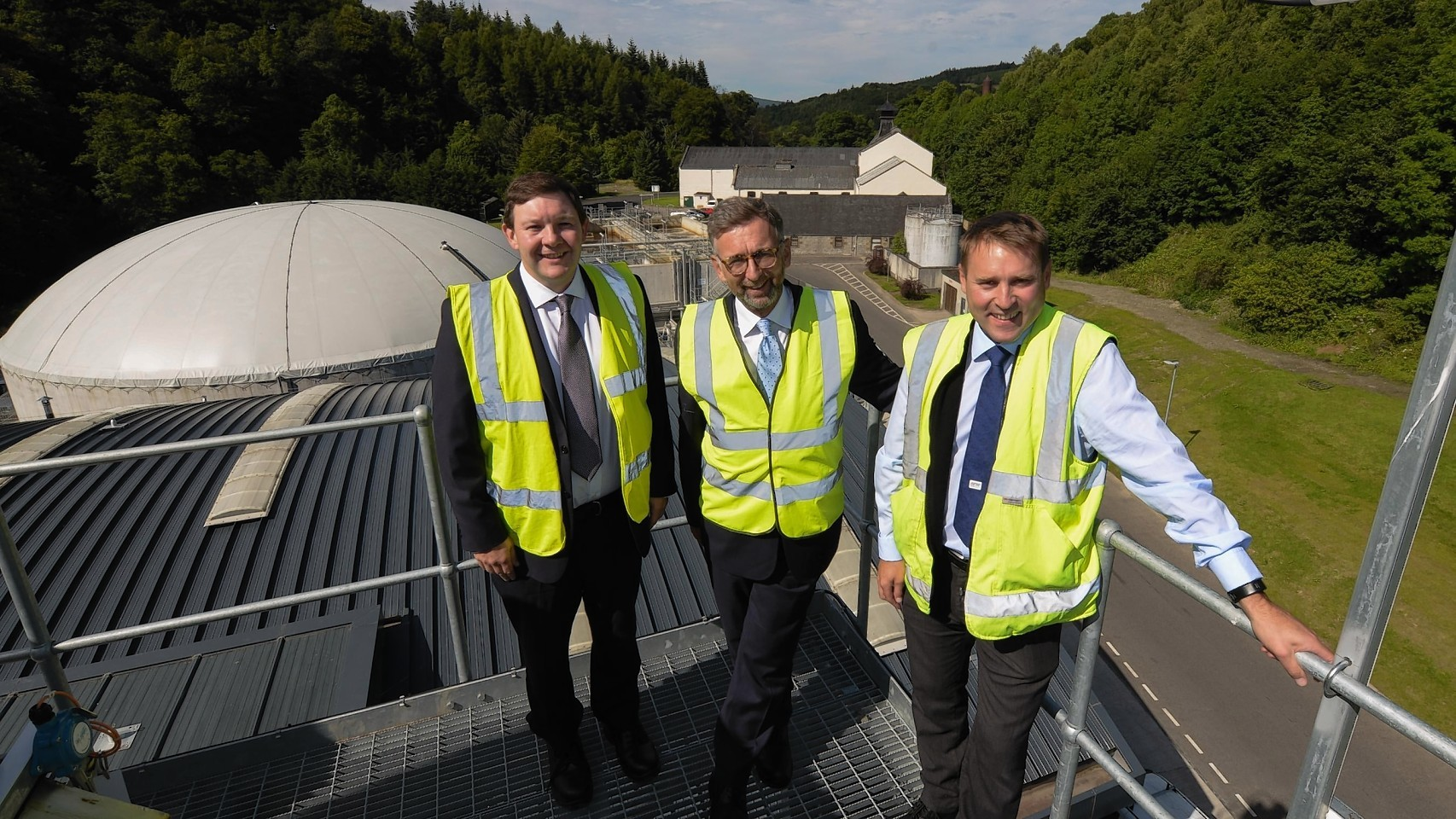 Lord Dunlop surveys the bioenergy plant with Keith Miller (left) and  Sean Pritchard (right)
