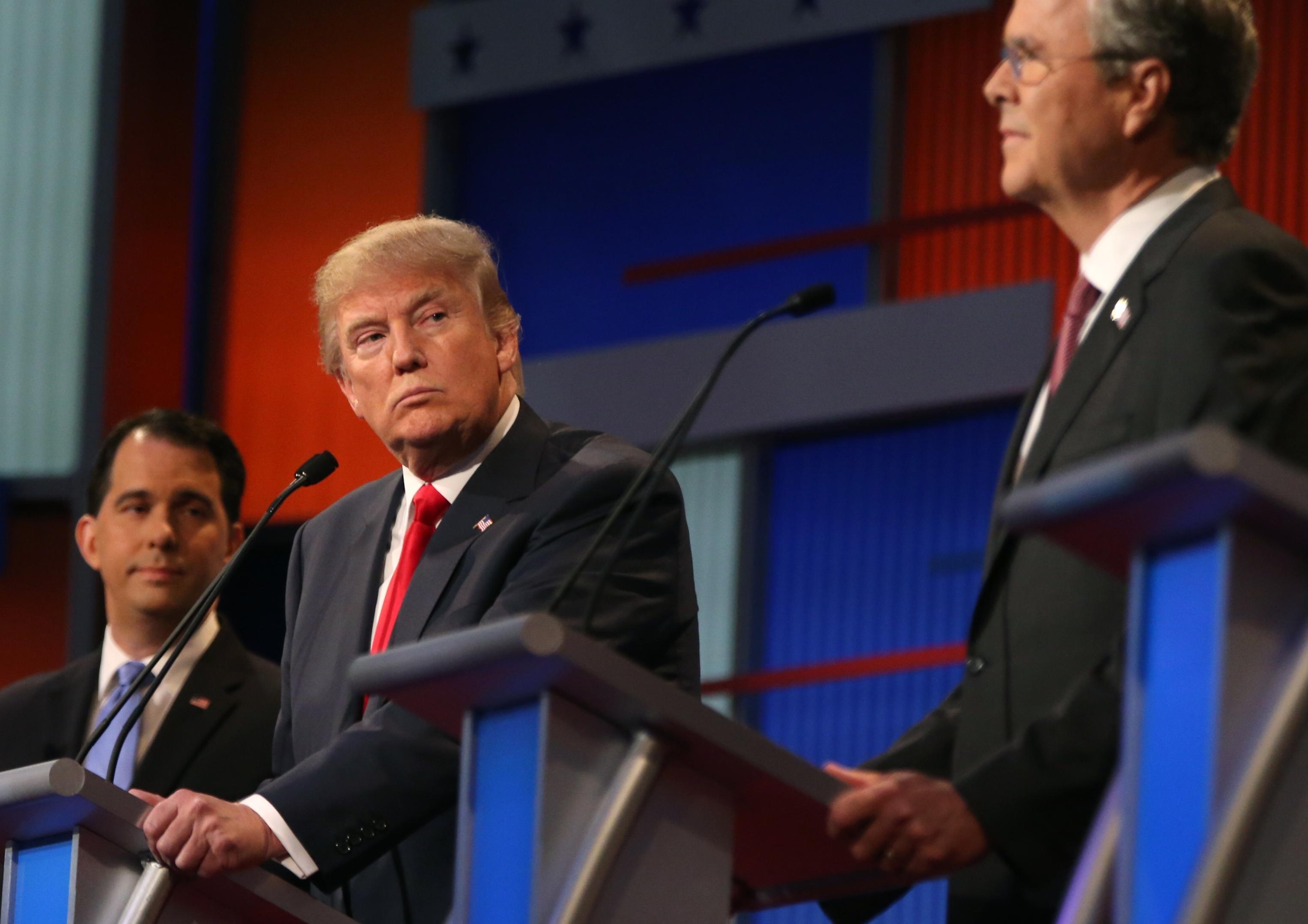Republican presidential candidate Donald Trump looks toward Jeb Bush