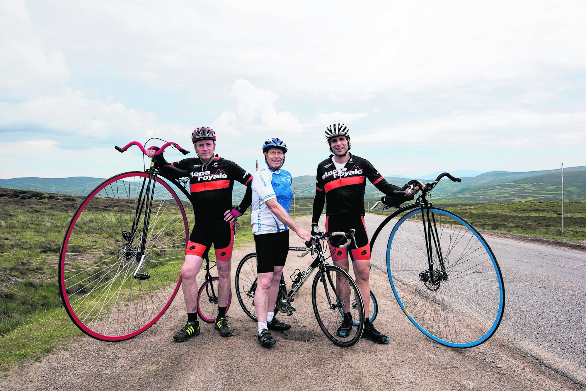 Pictured at the Lecht Ski Centre, near Tomintoul, during the 100-mile penny farthing ride, are, from left, David Fox-Pitt, Scott Armstrong, VisitScotland, and Mark Beaumont