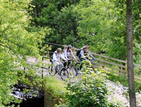 Cyclists on a section of the Speyside Way