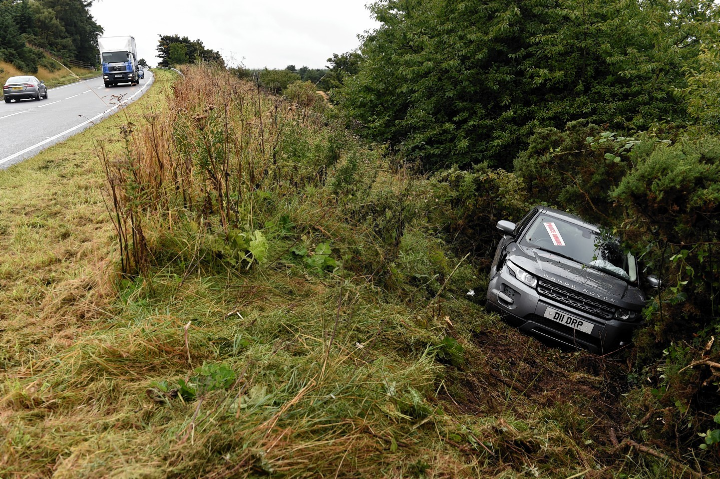 The Landrover ran down the side of the roadside embankment