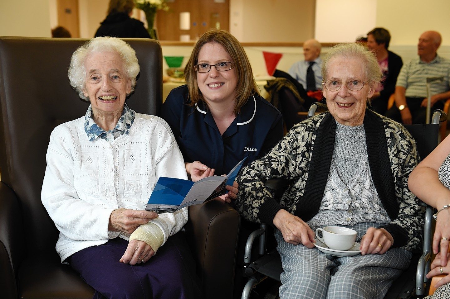 Residents and staff enjoying the ribbon cutting ceremony