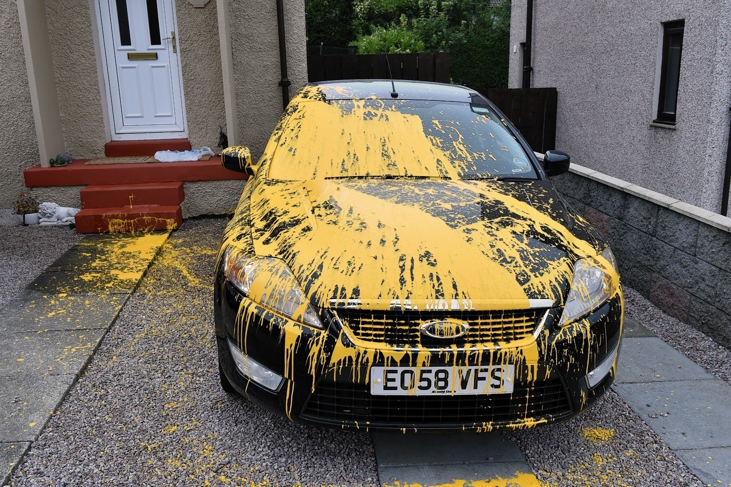 A Ford car was badly damaged with yellow paint on Byron Avenue
