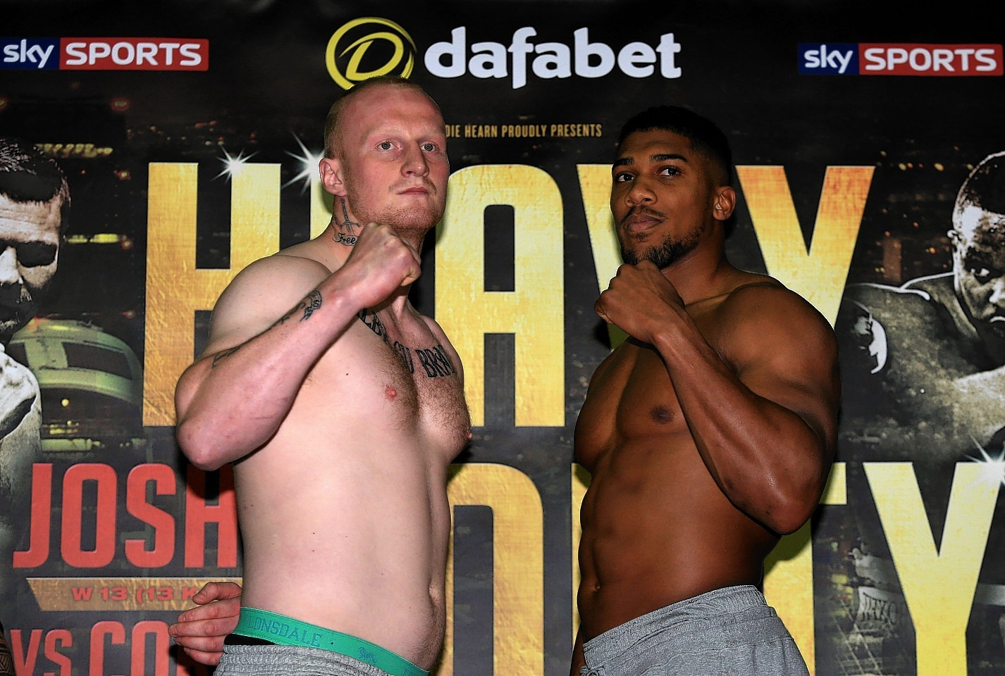 Anthony Joshua (right) and Gary Cornish during the weigh in at the Reebok Sports Club, London.