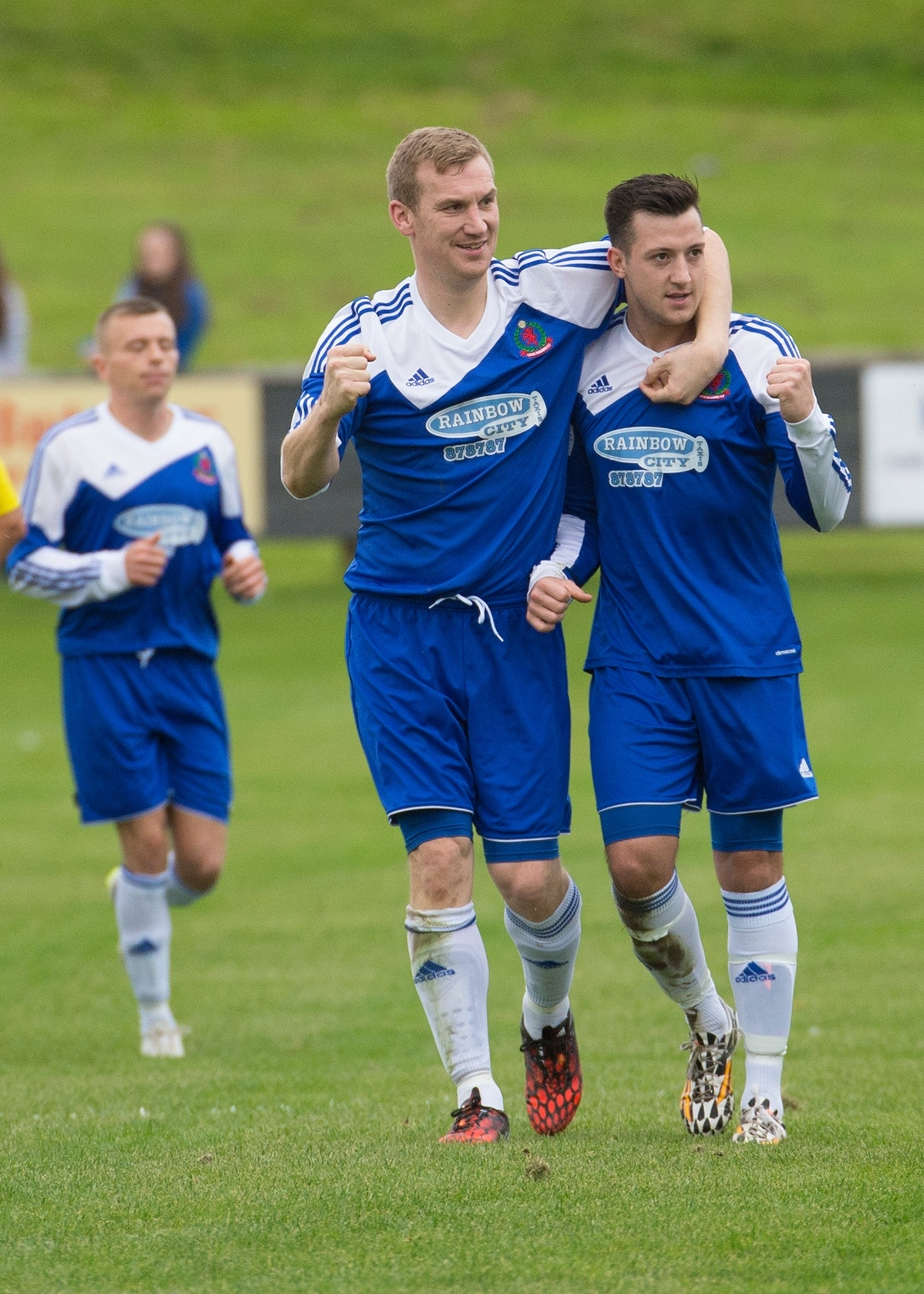 Cove's Eric Watson celebrates with goal scorer Connor Scully
