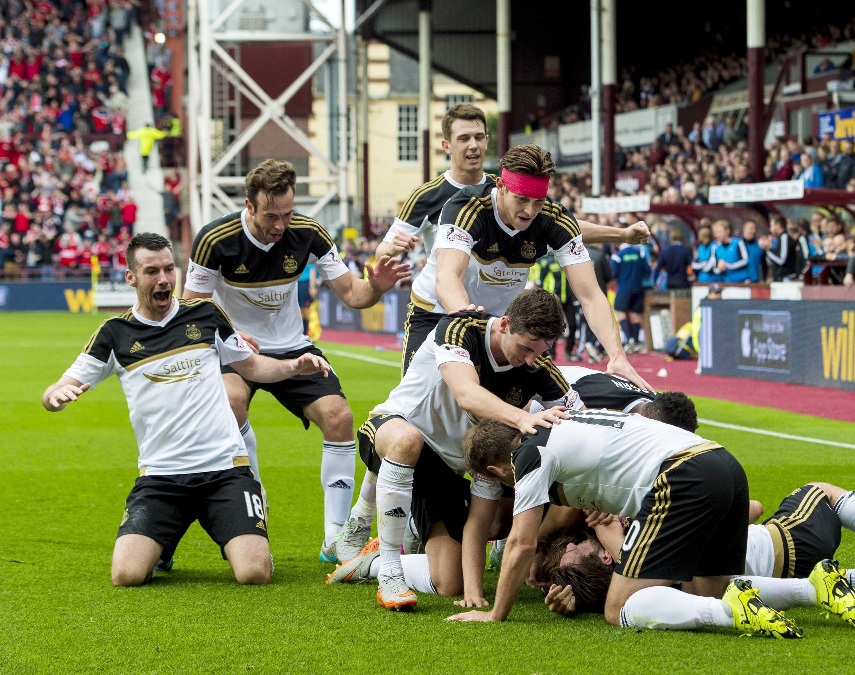 Aberdeen players surround goalscorer David Goodwillie as he puts his side 3-0 to the good