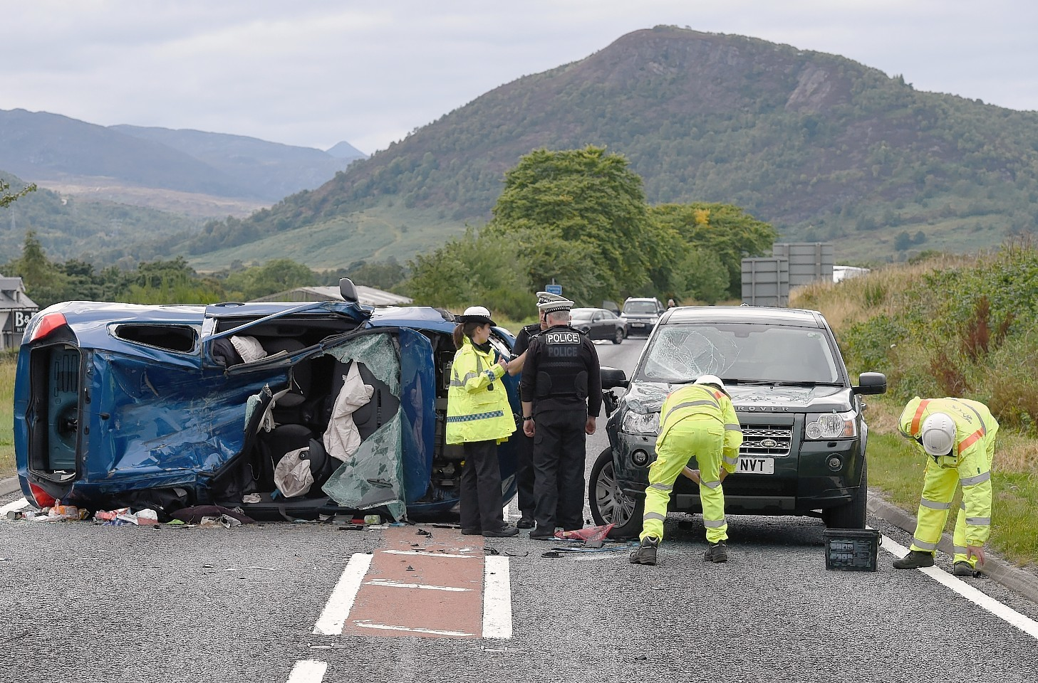 Picture by SANDY McCOOK  19th September '15 Police and recovery crews at the scene of yesterdaay afdternoons three car accident on the   A835 Maryburgh to Garve road at its junction with the A832 to Marybank. The vehicles involved were a Toyota Yaris, a Renault Clio and a Landrover Freelander.