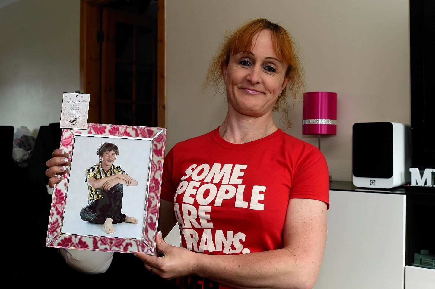 Justine Smithies with photograph of her son Cameron